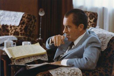 President Nixon reviews notes in Beijing