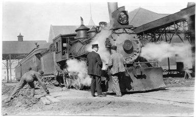 Train on a broken platform with three men