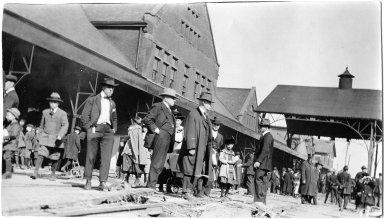 Crowd standing on a damaged train platform