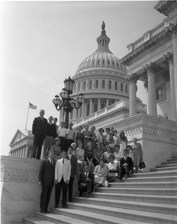 Senator Eugene J. McCarthy (D-MN) with a group on the U.S. Capitol Building steps