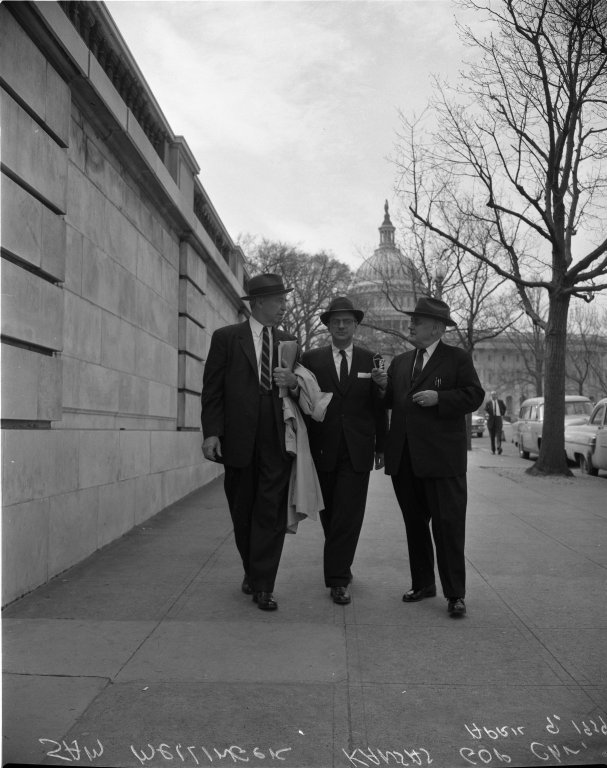 Senator Andrew F. Schoeppel (R-KS), Sam Mellinger, Kansas Republican Party Chairman, and unidentified man walking
