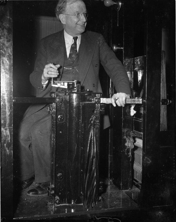 Senator Burton K. Wheeler (D-MT) at the controls of the Senate subway car