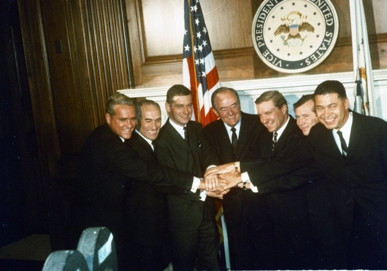 Vice President Hubert H. Humphrey in a 7-way handshake with new Senators