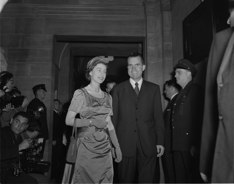 Queen Elizabeth II and Vice President Richard M. Nixon walking to a luncheon in the Old Supreme Court Chamber