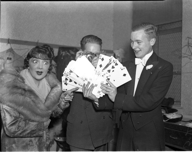 Irene Bordoni (singer) Bob Brockhusrt (cameraman) and Carl Mainfort (magician) pose for a photo