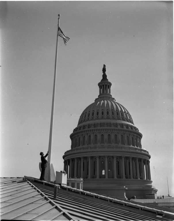 Raising the US flag at the U.S. Capitol Building, over the Senate Wing
