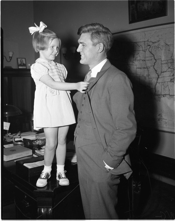 Senator Joseph H. Ball (R-MN) about to receive a Buddy Poppy from five year old Geraldine Reynolds