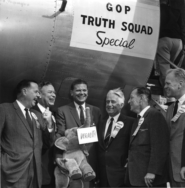 """Republicans standing next to """"GOP Truth Squad Special"""" airplane while campaigning for Richard M. Nixon and Henry Cabot Lodge, Jr."""