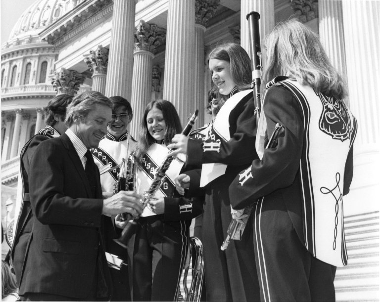Senator Charles H. Percy (R-IL) and members of the Harrisberg (high school?) band outside of the U.S. Capitol Building