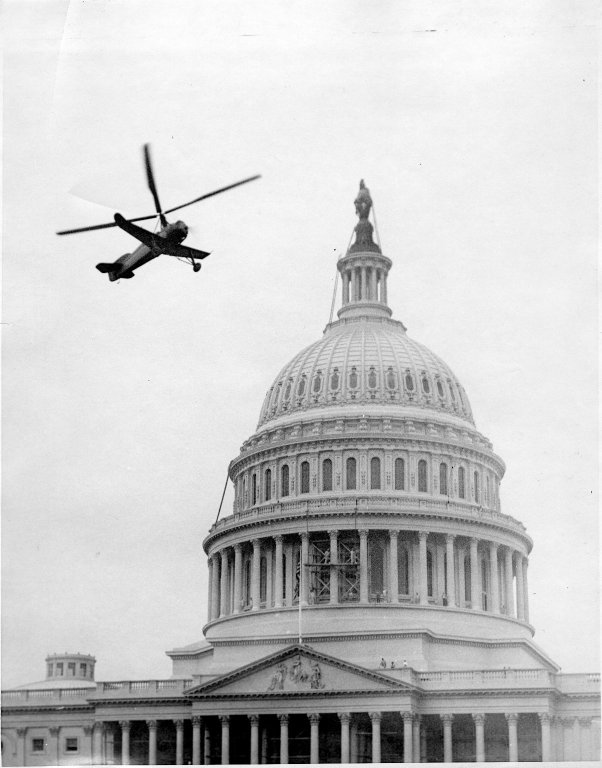 Autogyro aircraft in flight over the U.S. Capitol Building