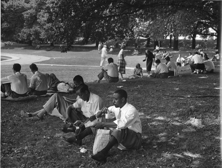 Civil Service workers eating their lunches behind the Munitions Building in Washington, DC