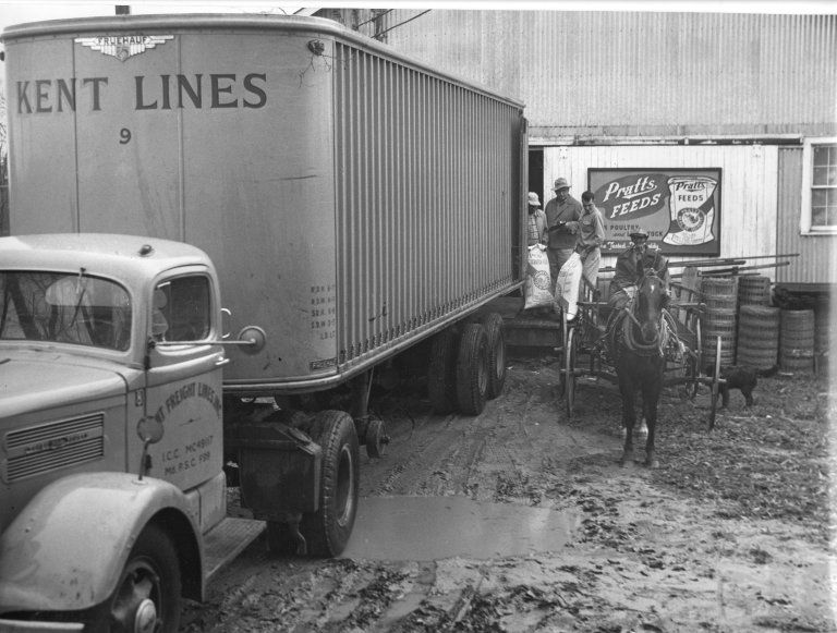 A Fruehauf trailer delivers farming supplies to a rural Maryland town with no railroad access
