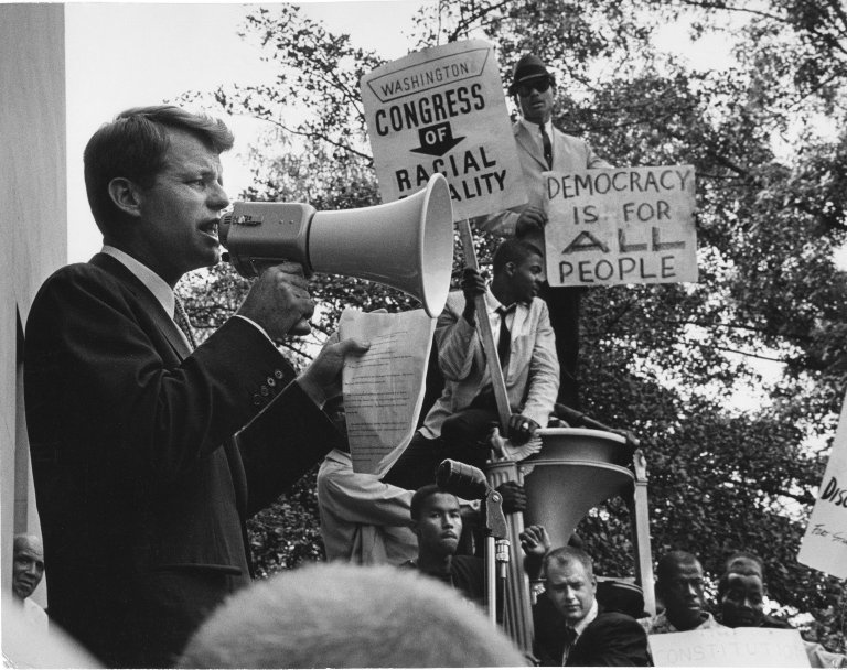 Attorney General Robert Kennedy talking via megaphone to protesters outside the Department of Justice