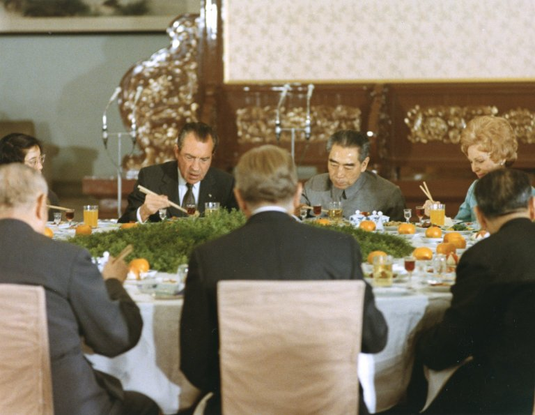 President Nixon, Mrs. Nixon and Premier of the People's Republic of China Zhou Enlai eating a meal during Nixon's historic trip to China