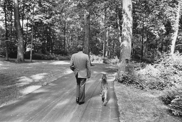President Nixon taking a walk with his dog