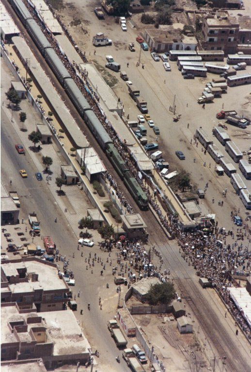Aerial view of crowds waiting for the train Presidents Nixon and Sadat of Egypt are on