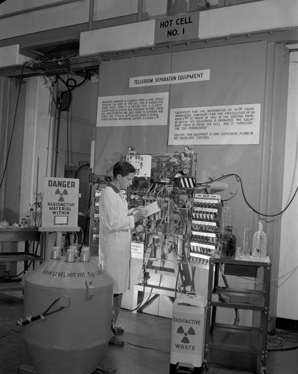 Scientist at the Atomic Energy Commission checks tellurium separation equipment
