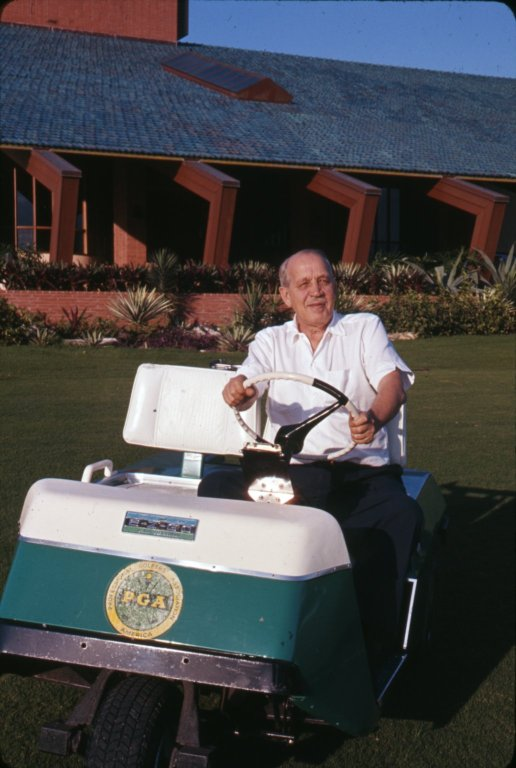 John MacArthur, one of the richest men in America, riding his golf cart in Florida