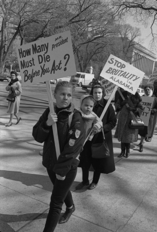 "Protesters outside of the White House urging President Johnson to respond to ""Bloody Sunday"" violence in Selma, Alabama"
