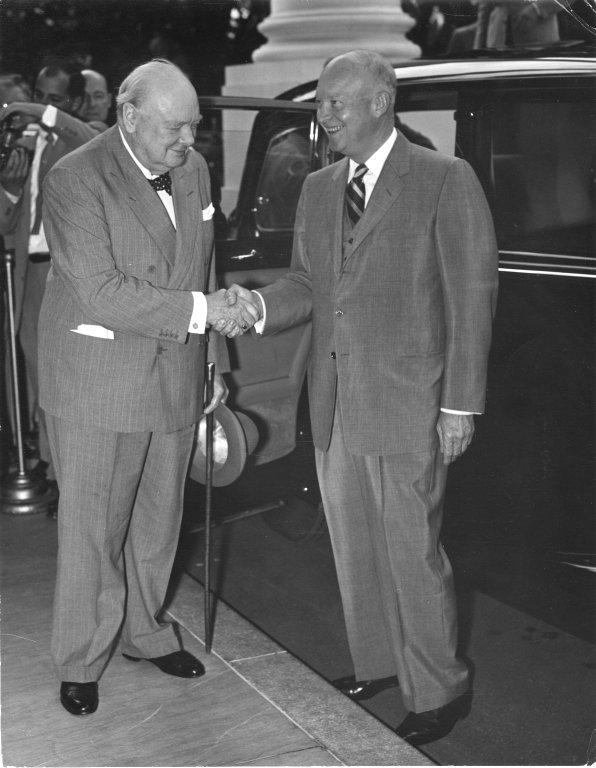 President Eisenhower shakes hands with British Prime Minister Winston Churchill