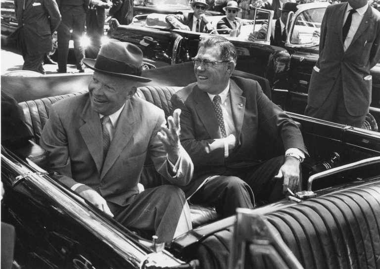 Eisenhower in a car with an unidentified man