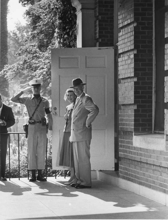 Mr. and Mrs. Eisenhower leave an unidentified building