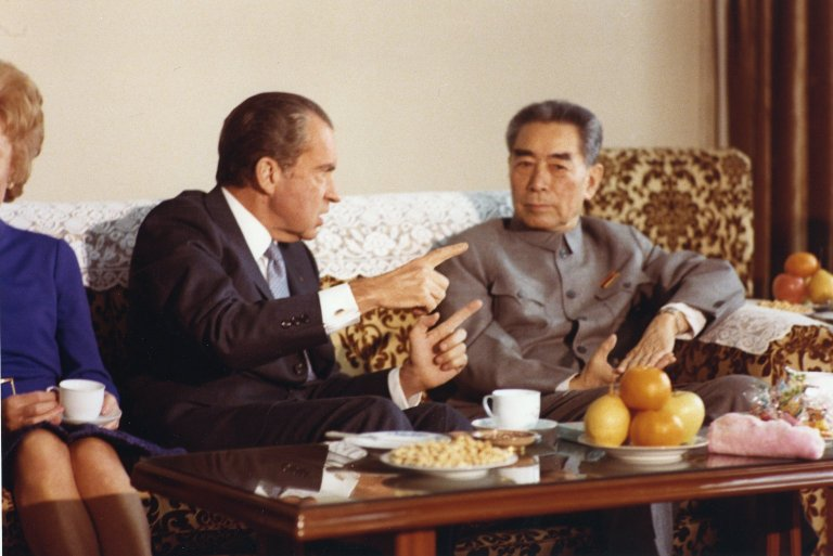 President Nixon gestures during a meeting with Chinese Premier Zhou