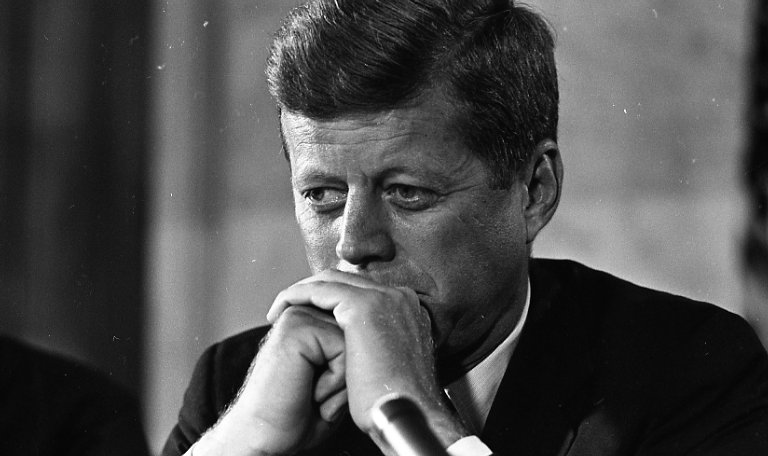 Kennedy with hands clasped