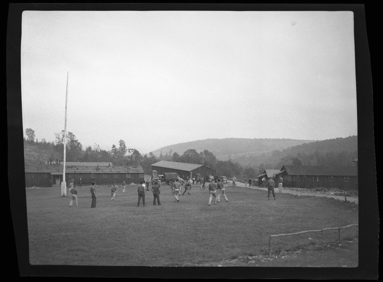 Civilian Conservation Corps (CCC) camp with men playing football