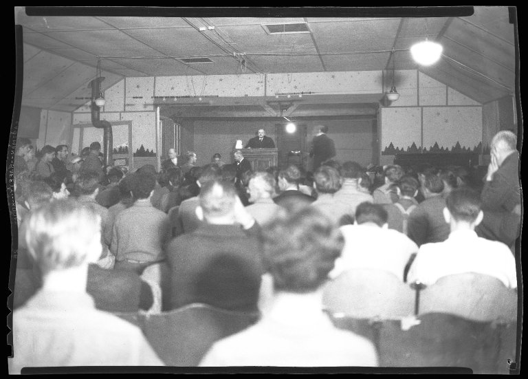 Audience at an unknown play performed at a Civilian Conservation Corps (CCC) camp