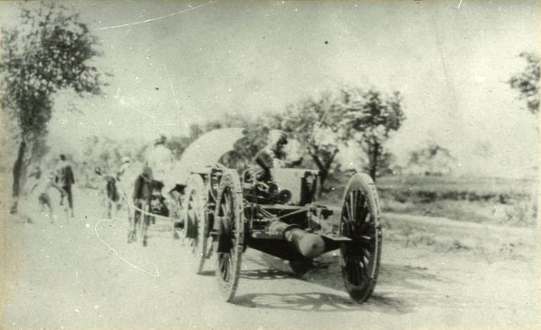 Soldiers towing cannon