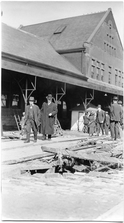 Crowd standing on a damaged train platform