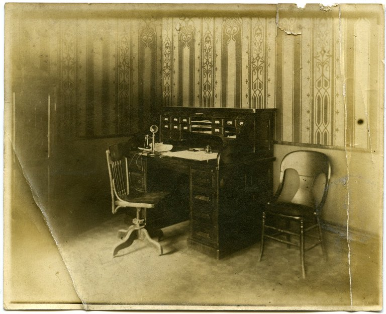 Desk with chairs and telephone