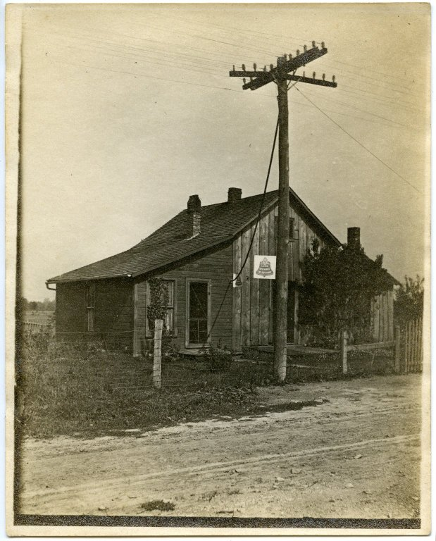 House with telephone sign