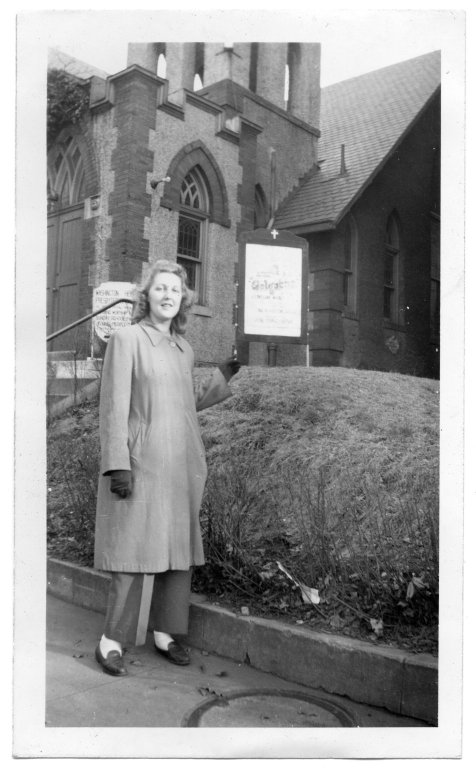 Portrait of Mary Elsie Fox in front of a church