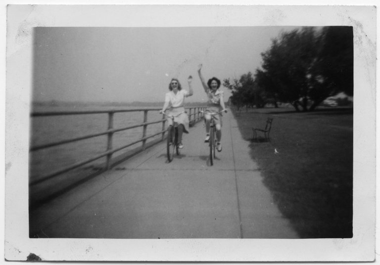 Mary Elsie Fox and friend riding bicycles
